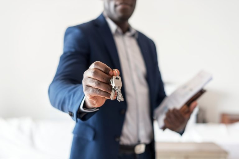Man reaching out a key