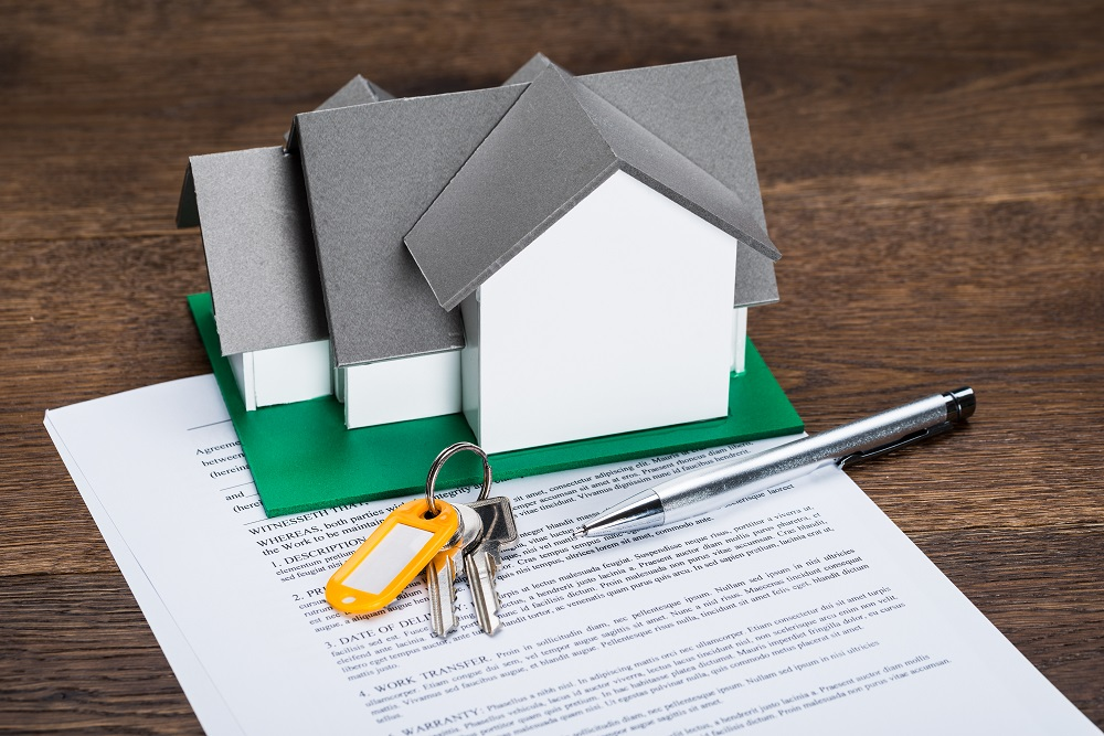 Home figure on top of a contract
