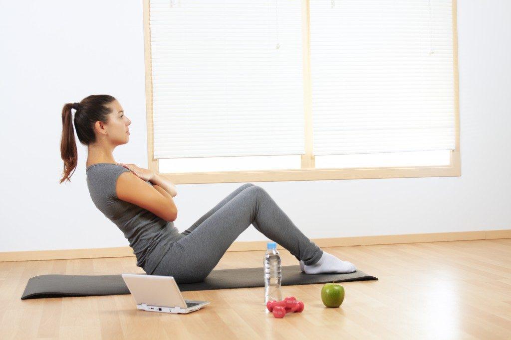 girl doing sport exercises at home