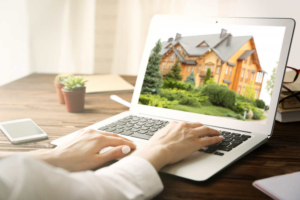 woman looking at property on her laptop